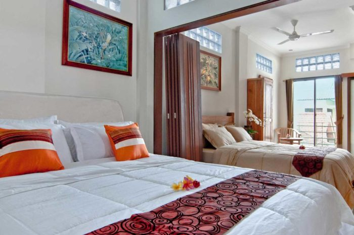 Kuta Ecostay Suite - Water colour painting of Bali birdlife by a local artist in each room
