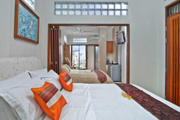 Kuta Ecostay Suite - two bedrooms separated by movable partition